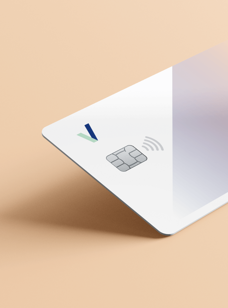 White contactless Pervesk Visa debit card in a pink background.